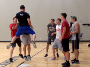 """A participant in the inaugural """"Kickin' for Kids"""" kickball tournament celebrates with his teammates after kicking a home run. The tournament is put on by two Greek organizations at the South Dakota School of Mines and Technology. Photo Date: Sep. 29, 2018."""