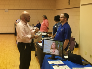 "A job seeker talks to a prospective employer at the Goodwill ""Rocktober"" Job Fair. A large number of attending businesses and organizations, as well as high placement numbers indicate a strong economy in the Rapid City area. Photo Date: Oct. 3, 2018."