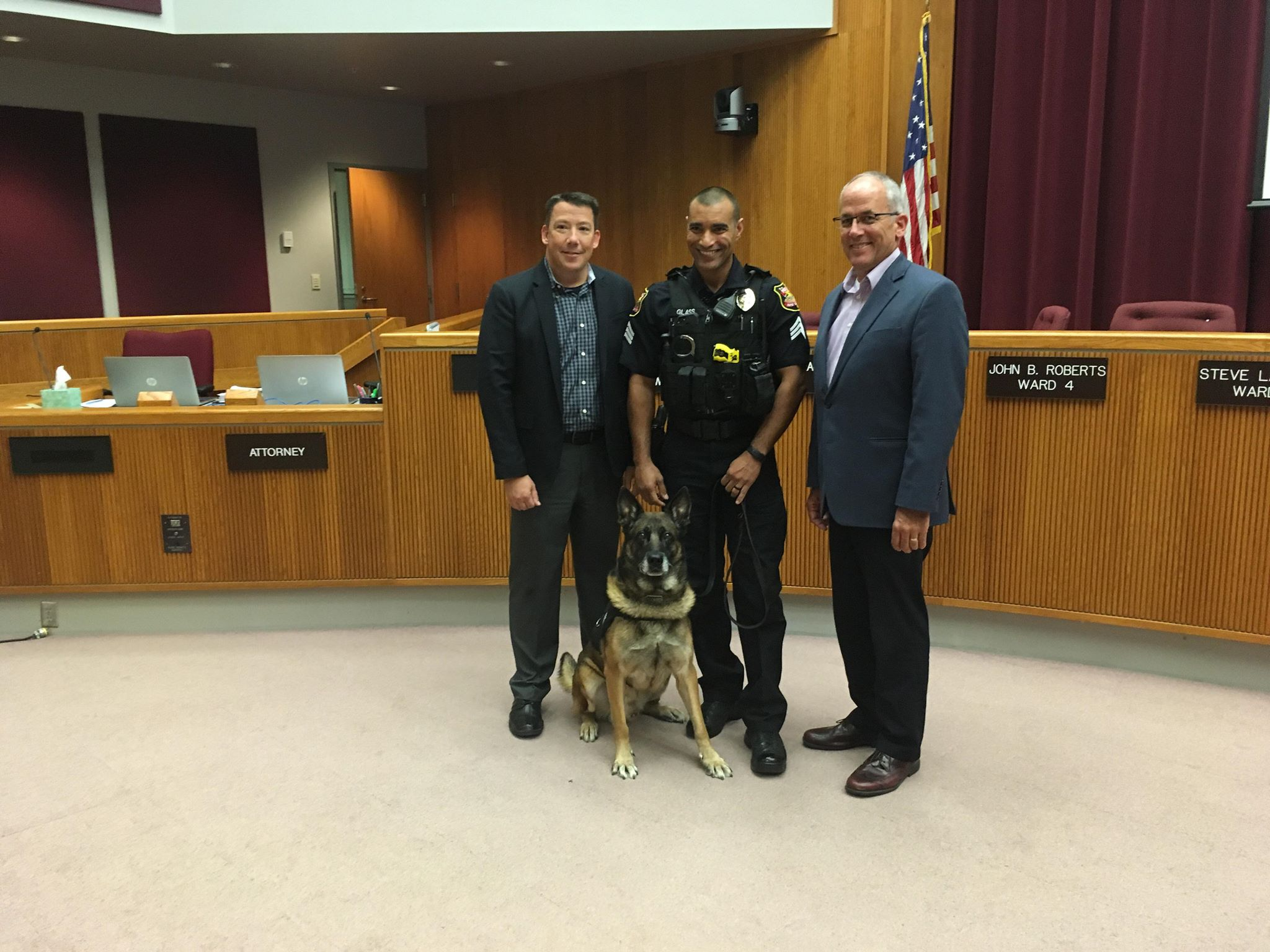 RCPD K9 unit Jackson poses with city officials celebrating his retirement after 9 years.