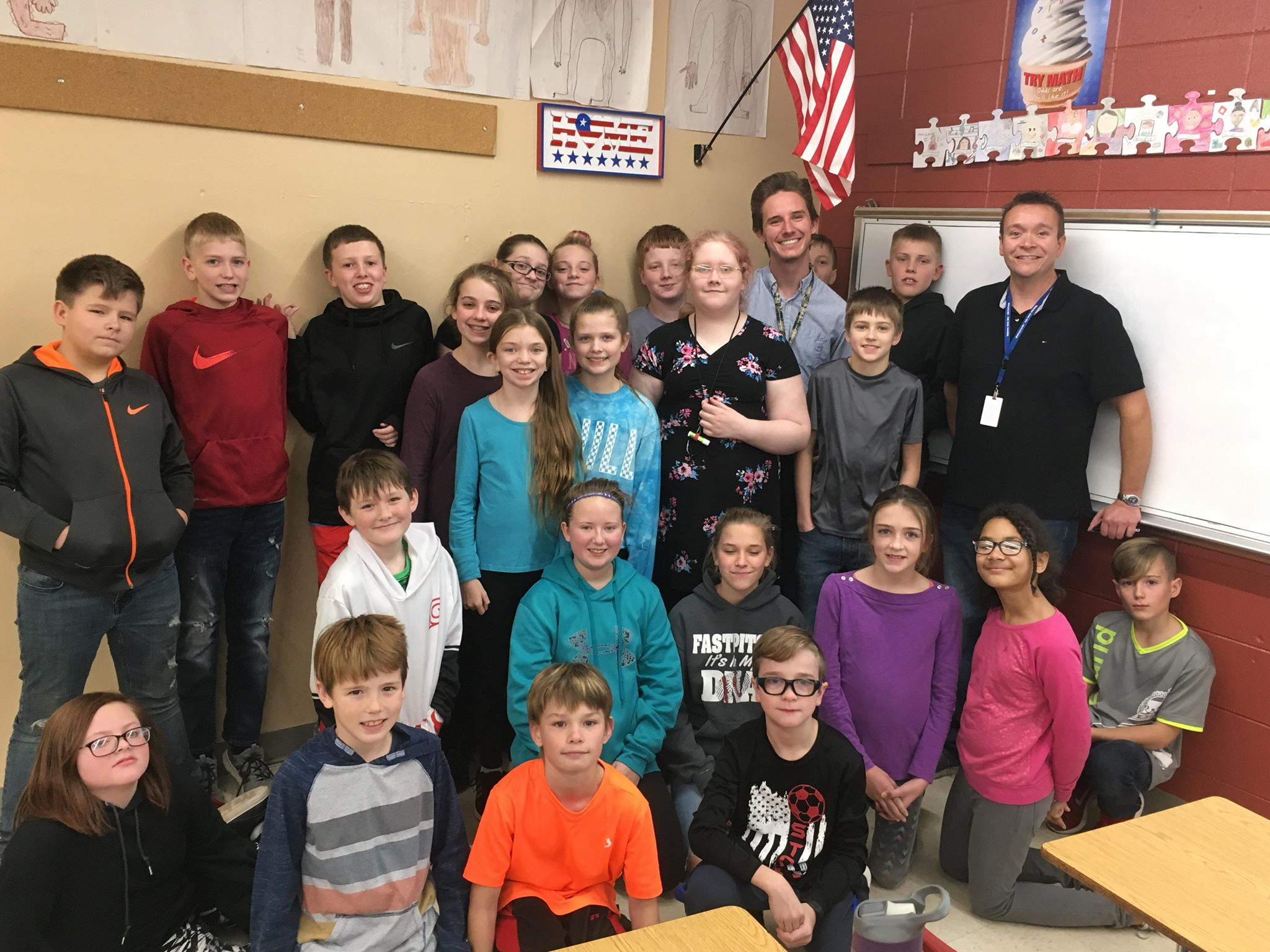 Calvin Cutler and Justin Wickersham visit with students at Sturgis Williams Middle School on Wednesday, Nov. 28, 2018.