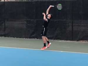 Image of a boys tennis match between St. Thomas More and Aberdeen Central