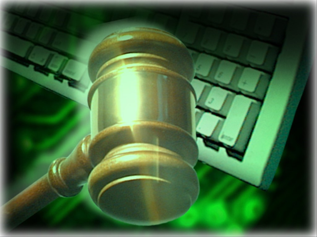 MGN graphic gavel over keyboard