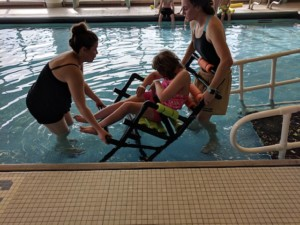 Jamie Schroeder with student and adaptive chair