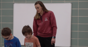 Jamie Schroeder with students in PE class