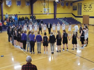 Volleyball Teams praying for Taylor
